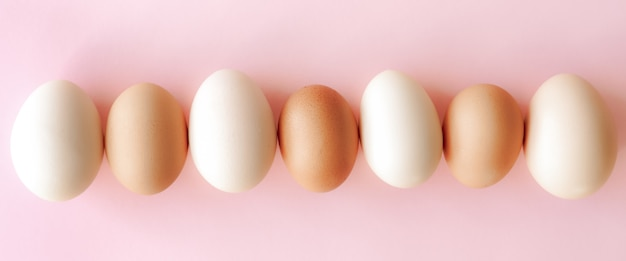 White and brown eggs background