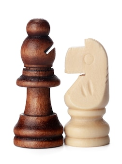 White and brown wooden chess pieces on white background