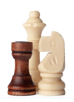 White and brown wooden chess pieces on white surface