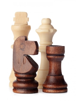 White and brown wooden chess pieces
