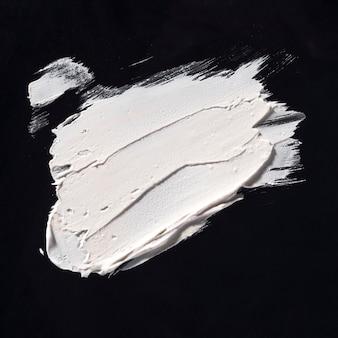 White brush stroke on black background
