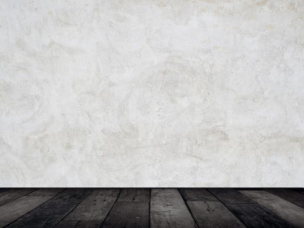 黒い木製製品のディスプレイの背景と白いブラシをかけられたコンクリートの壁