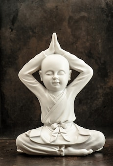White buddha sculpture on dark background. meditation and relaxing