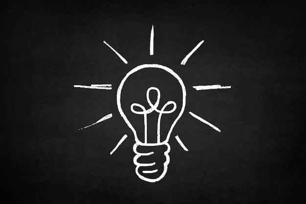 White bulb drawn on a blackboard