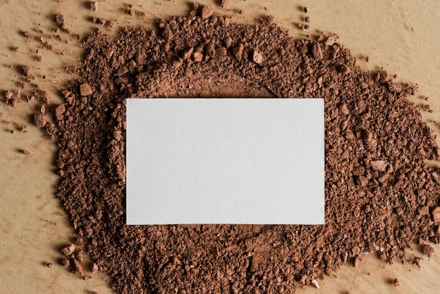 White business card on dirt