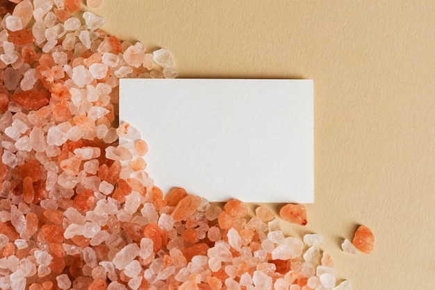 White business card on orange pebbles