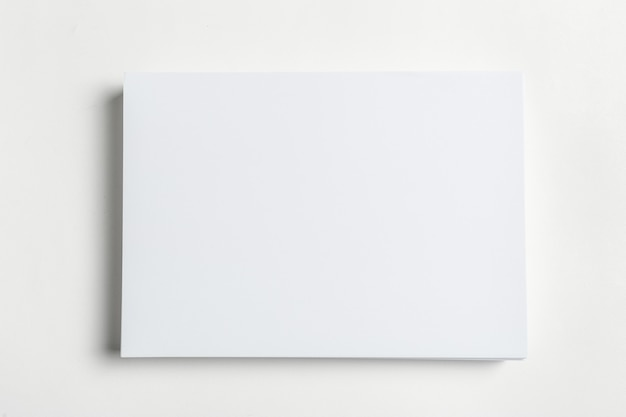 White business card on wooden table. blank portrait a4.