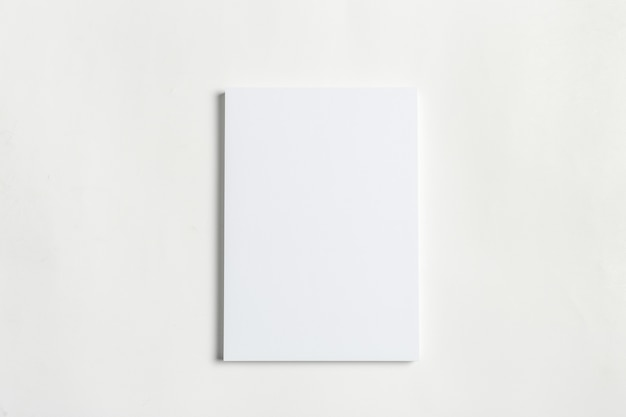 White business card on wooden table. blank portrait