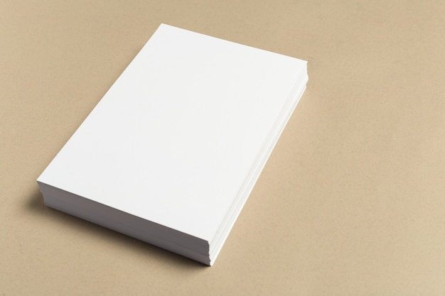 White business card on wooden table.