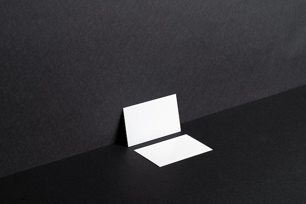 White business cards on black table