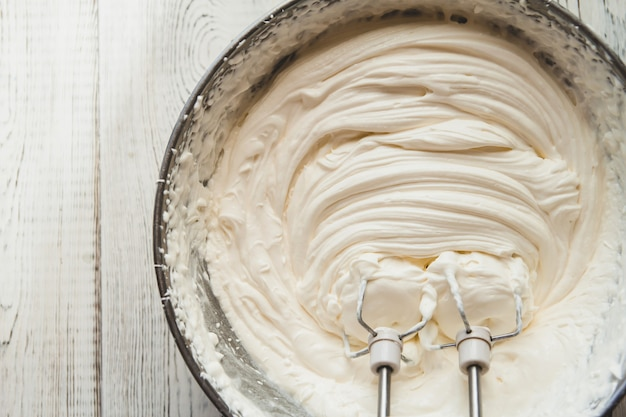 White butter cream in a metal bowl