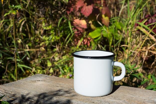 White campfire enamel mug mockup with sun beams