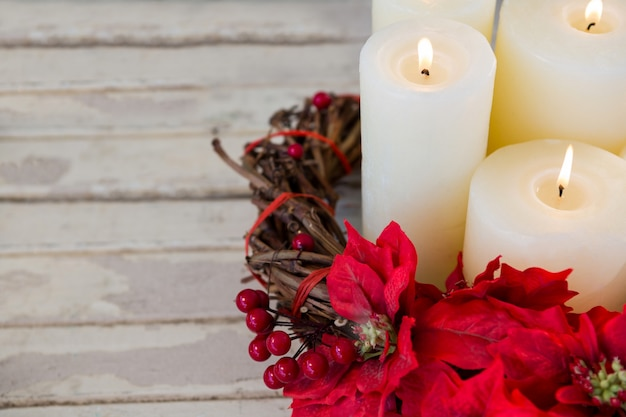 White candles lit with red flowers