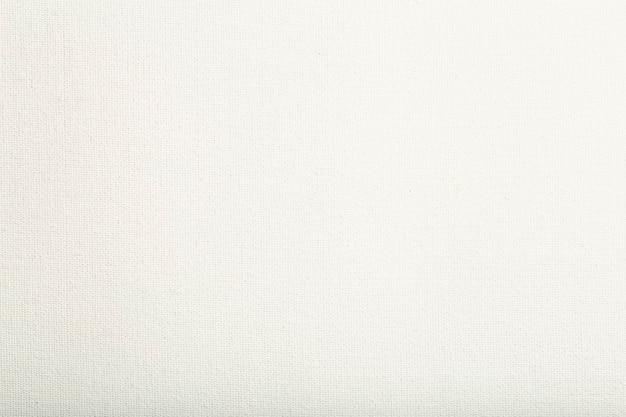 写真の高品質の写真を描くための白いキャンバスの背景のキャンバスのテクスチャ