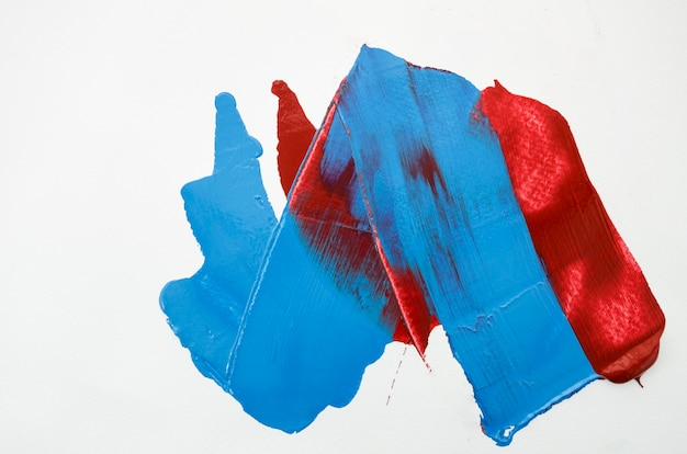 White canvas with red and blue strokes