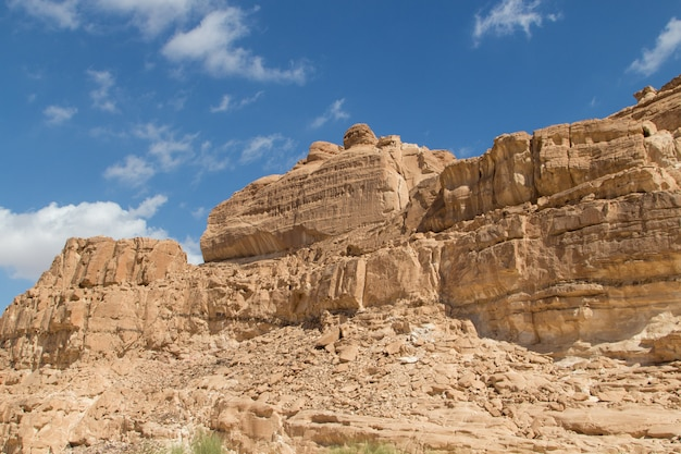 White canyon with yellow rocks and blue sky