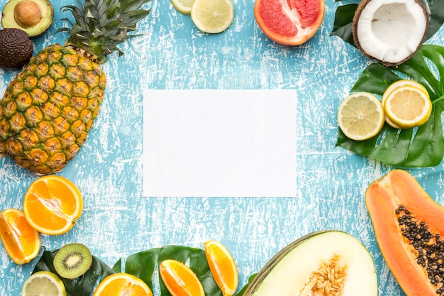 White card surrounded by exotic fruits