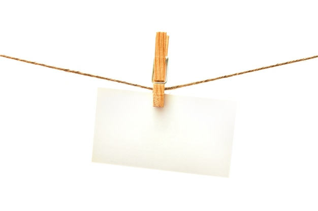 White card with clothes peg isolated