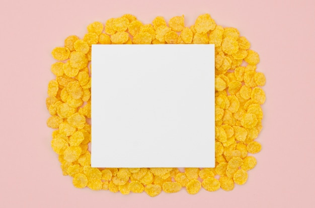 White card with copy space surrounded by cornflakes