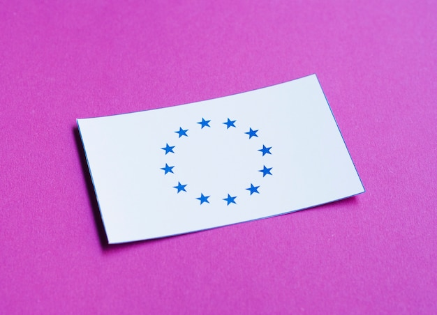 White card with european flag on purple background