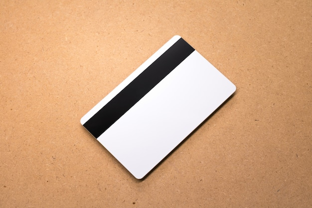 White card on wooden background. template of blank credit card for your design.