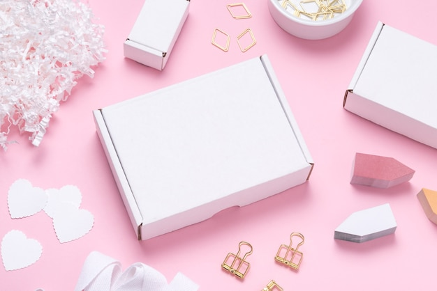 White cardboard box on color office desk