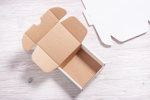 White cardboard carton box on wooden desk,