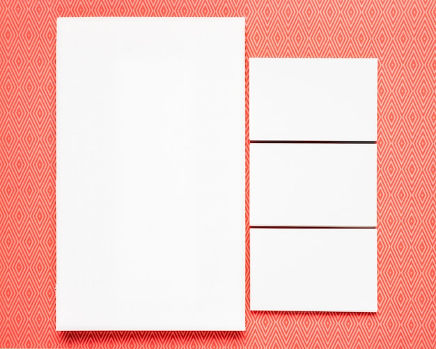 White cards on orange background