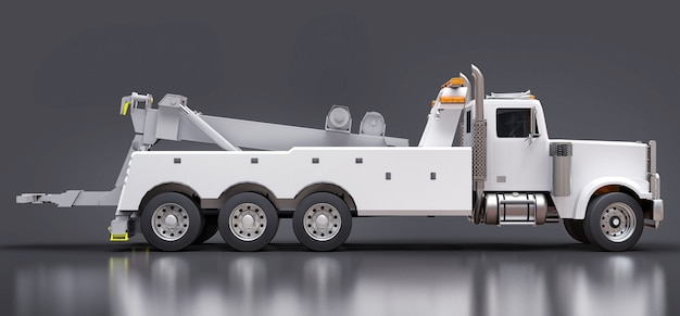 White cargo tow truck to transport other big trucks or various heavy machinery