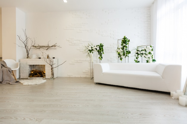 White carpet in front of settee in apartment interior with painting and lamp.