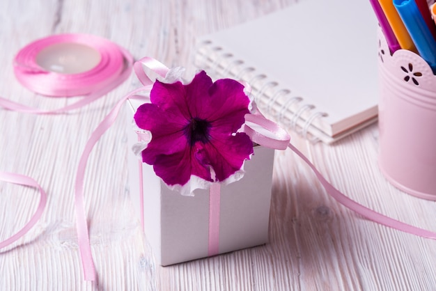 White carton gift box with flower