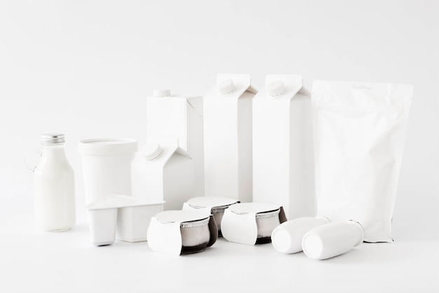 White carton packages and bottles for liquid