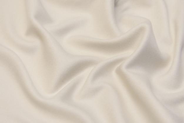 Белая кашемировая ткань текстуры фона