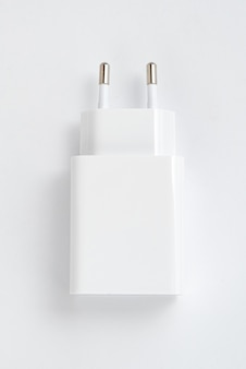 White cell phone charger on the white isolated background