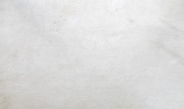白いセメントの壁の背景。上面図