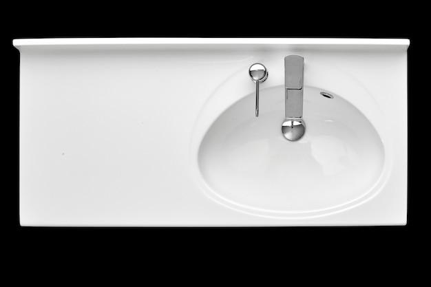 White ceramic bathtub sink on isolated black background