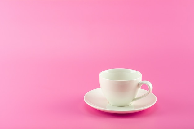 White ceramic coffee in pink.