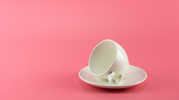 White ceramic coffee on pink
