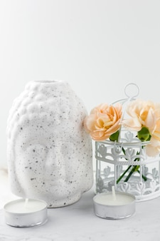 White ceramic figurine buddha head  ,decorative cage with flowers and candles