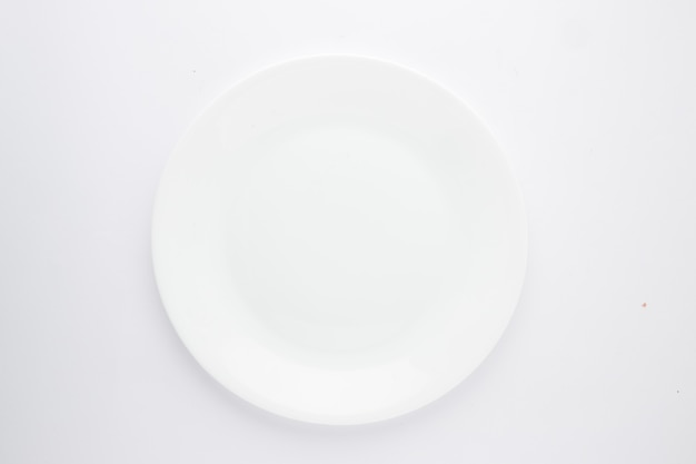 White ceramic plate different shapes of an empty white ceramic  tableware