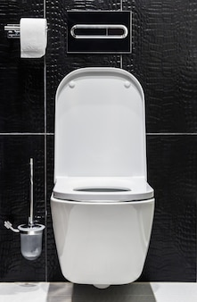 White ceramic toilet with the lid open