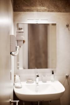 White ceramic washbasin, glossy metal faucet