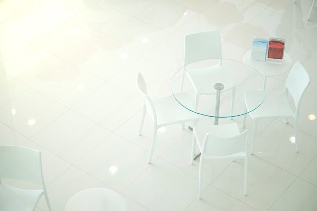 White chair for the customer testimonials in car showroom