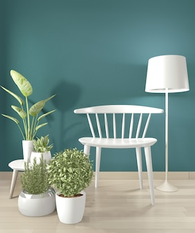 White chair and decoration in modern empty dark green room. 3d rendering