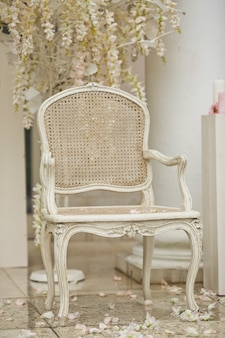 White chair stands on white petals outside