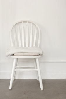 White chair on wall background
