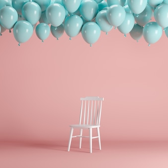 White chair with floating blue balloons in pink background room studio