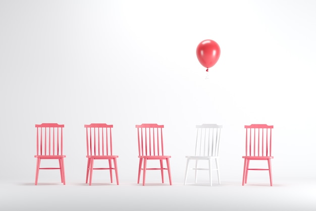 White chair with floating red balloon among white chair on white background