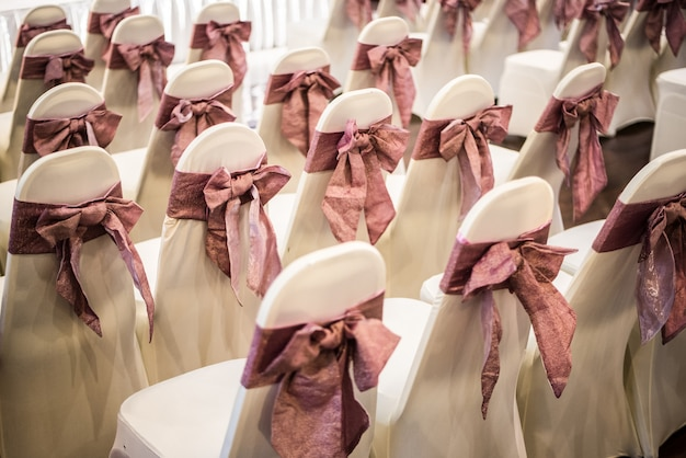 White chair with pink bow for the ceremony