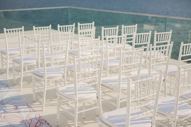 White chairs closeup on background